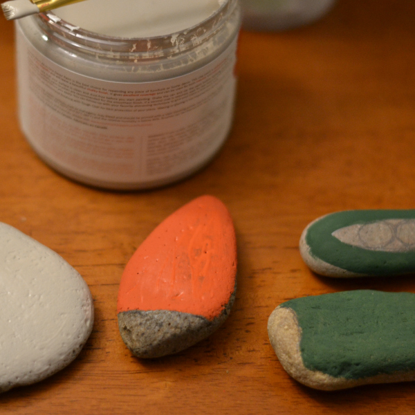 partially painted rocks sitting on a table