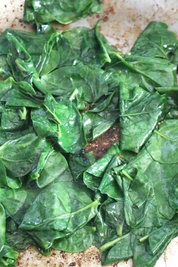 garlic spinach pan seared cooked spinach leaves