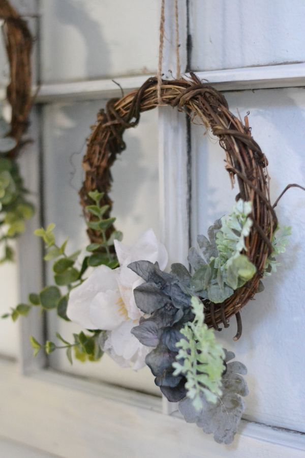 spring mini-wreath hanging from a window