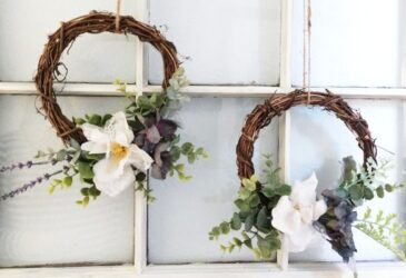 spring wreaths hanging from an upcycled window