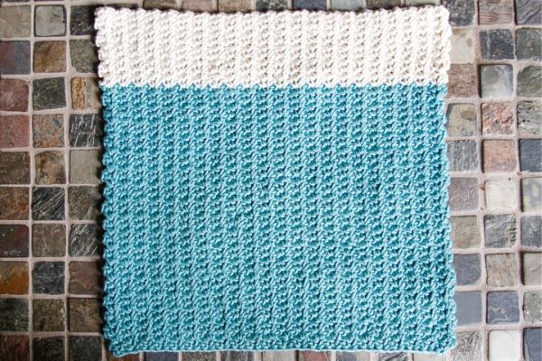 teal and white yarn turned into a crochet dishcloth