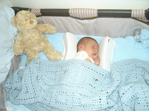 Spiderweb crochet baby blanket in light blue