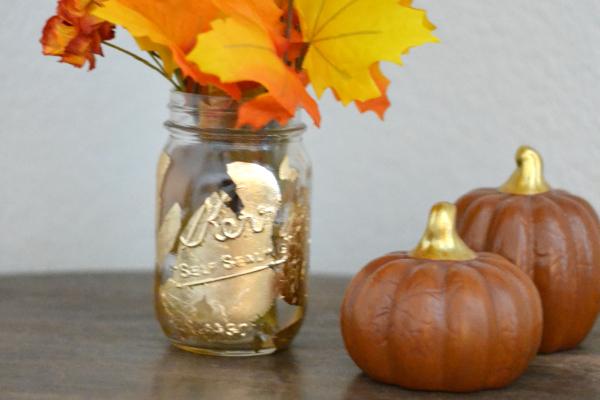 fall gold leaf mason jar vase sitting on a table