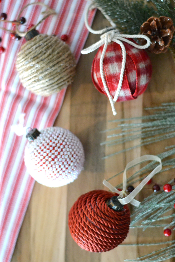 handmade upcycled ornaments sitting on a table