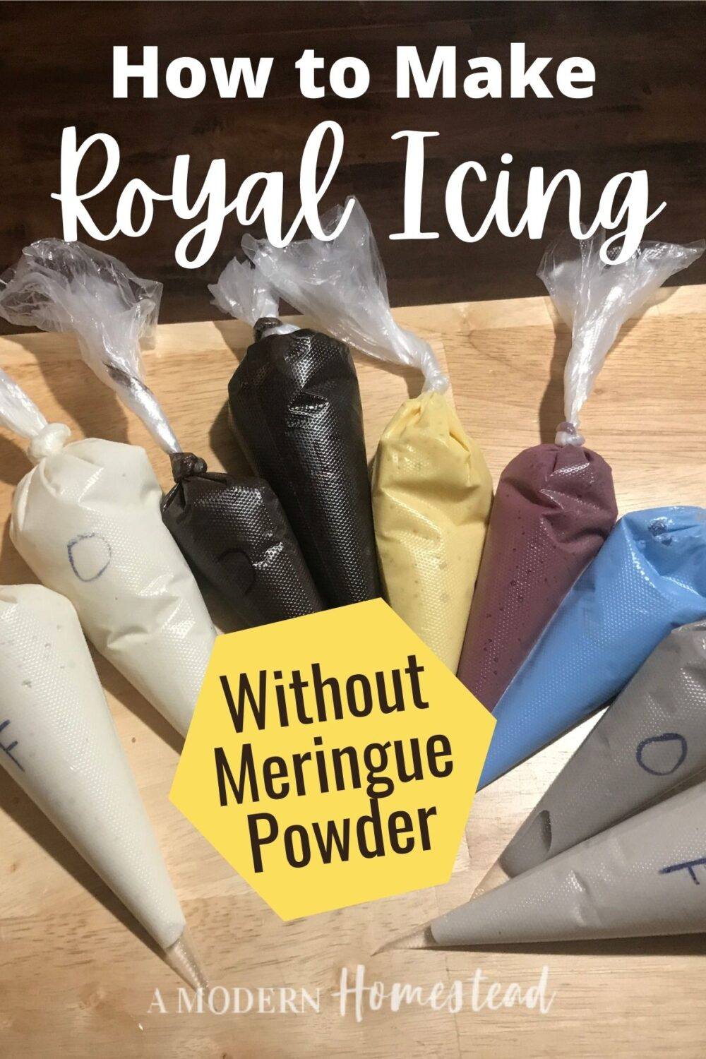 9 different colors of homemade royal icings in piping bags