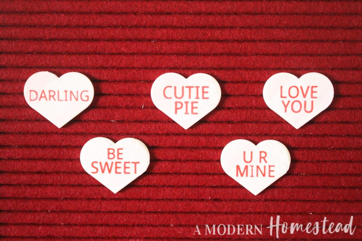 close up of Candy Hearts Letter Board Icon Set on red letter board