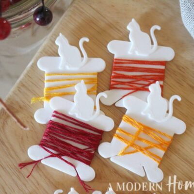 cat shaped thread bobbins with fall colored thread around them