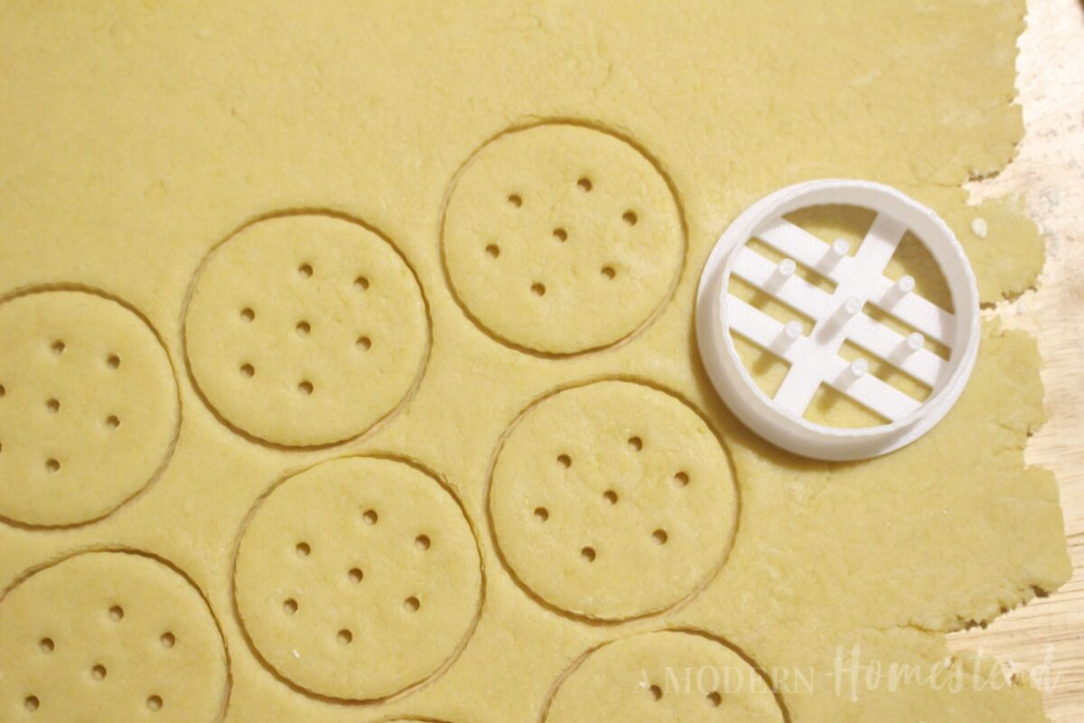 Cracker dough cut out in shapes of Ritz Crackers
