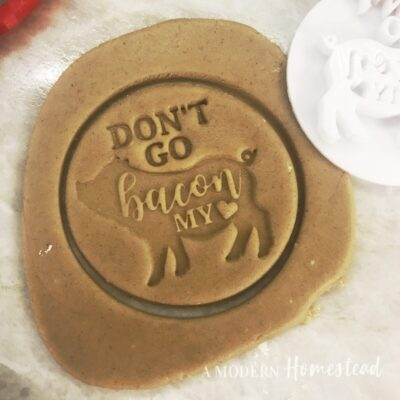 Don't Go Bacon My Heart valentine's day cookie cutter with pig outline in dough