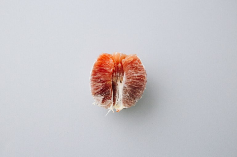 A blood orange that's shape is similar to a vagina.