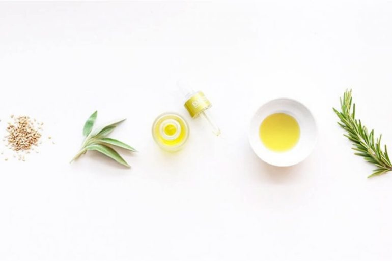 Flatlay of skincare ingredients including oil.