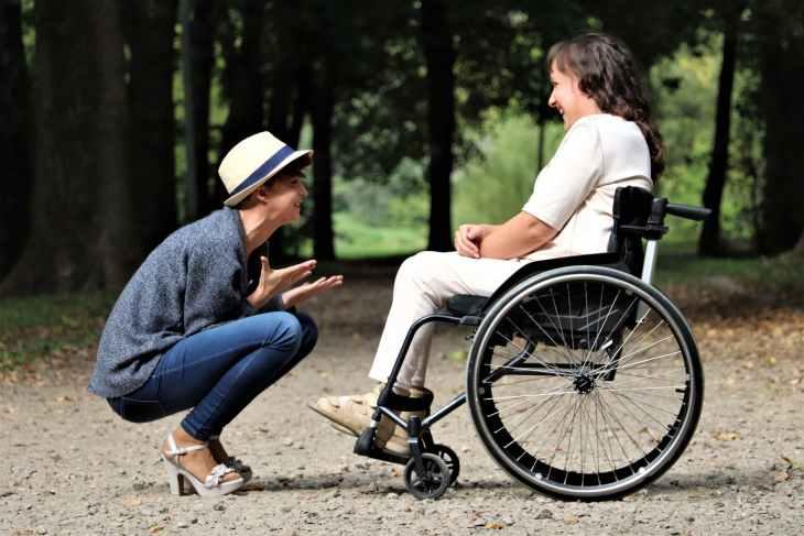 woman on black folding wheelchair
