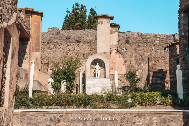 statues among ruins in Pompeii