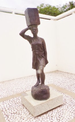 "Museum courtyard - statue of a woman carrying a heavy burden. Sculpture by Erbo Stenzel, 1944, ""Agua pro morro."""