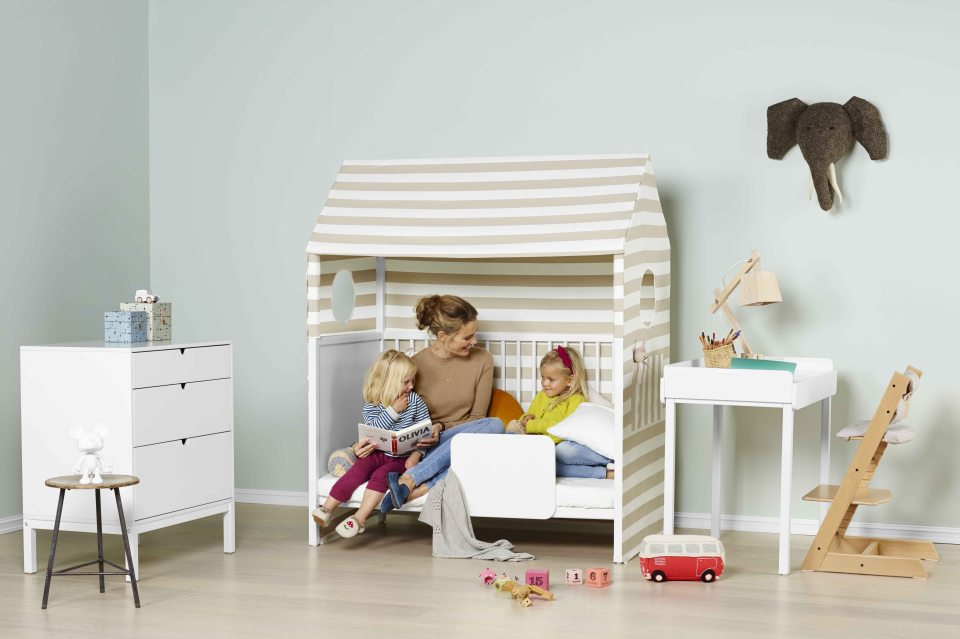 Stokke® Home™ Bed with Tent textiles, Stokke® Home™ Dresser and Stokke® Home™ Changer as desk.