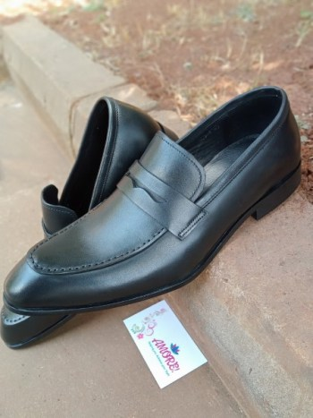 Black pointed penny loafer