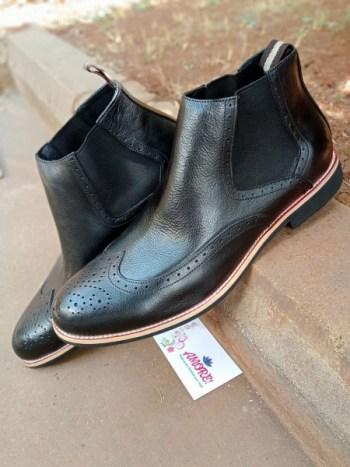 Black wing tip chelsea boot