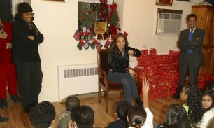 Thalia Joins Broadway Housing Project Children From The Robin Hood Foundation After School Program to Hand Out Holiday Gifts (4)