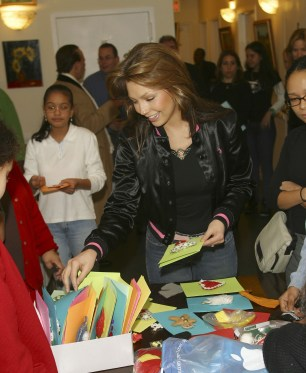 Thalia Joins Broadway Housing Project Children From The Robin Hood Foundation After School Program to Hand Out Holiday Gifts (6)