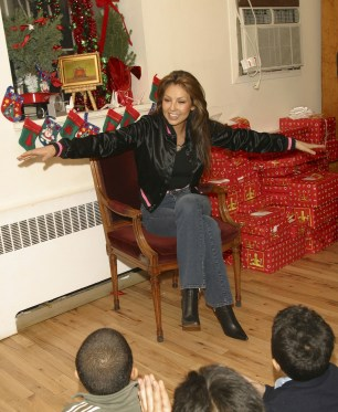 Thalia Joins Broadway Housing Project Children From The Robin Hood Foundation After School Program to Hand Out Holiday Gifts (7)
