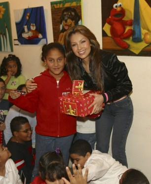 Thalia Joins Broadway Housing Project Children From The Robin Hood Foundation After School Program to Hand Out Holiday Gifts (9)