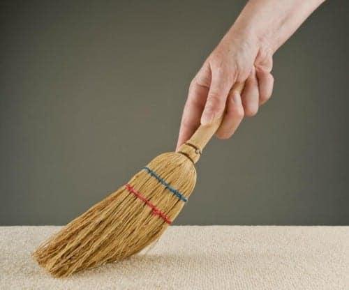 mom sweeping rug