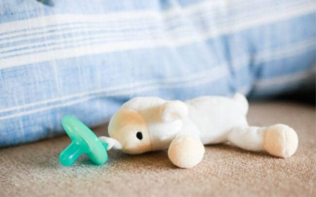 pacifier with stuffed sheep attached