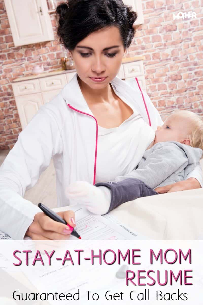 stay at home mom breastfeeding her baby while filling out a resume
