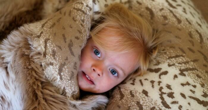 girl lying in blankets