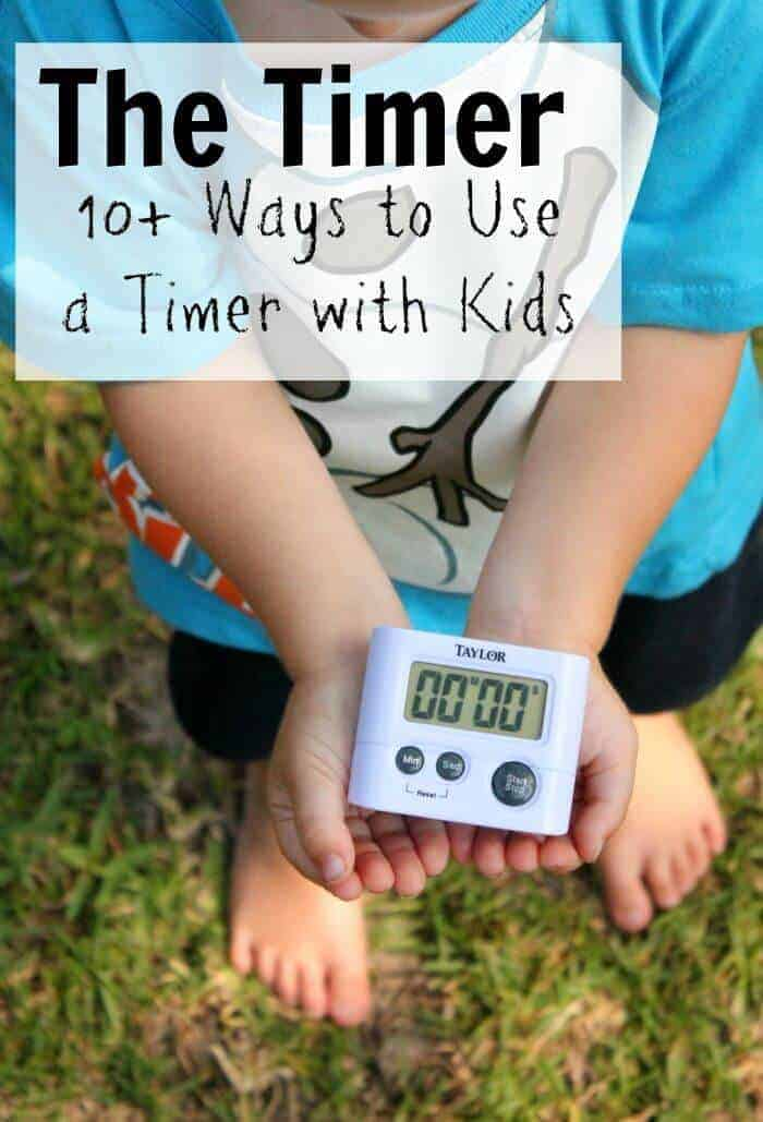 kid holding a timer