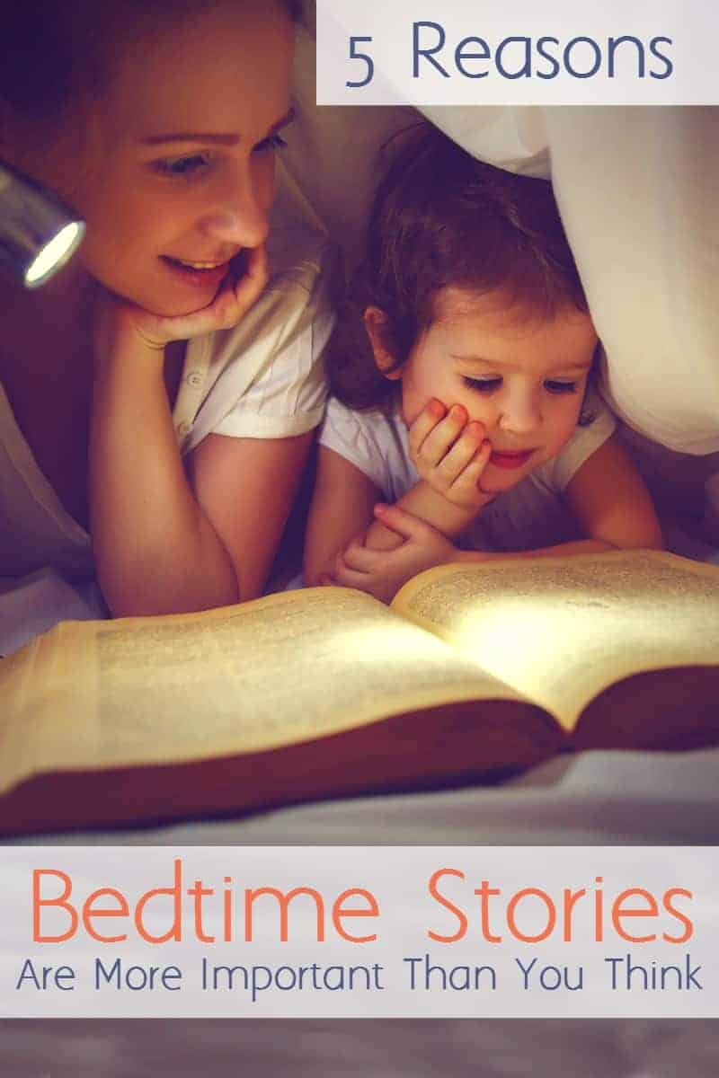 mother reading bedtime story to toddler under sheets with a flashlight