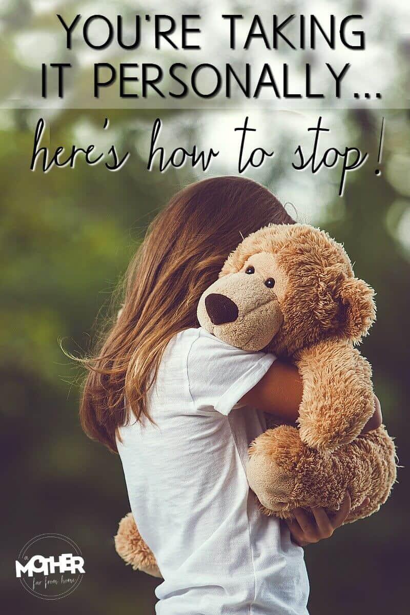 little girl hugging a teddy bear