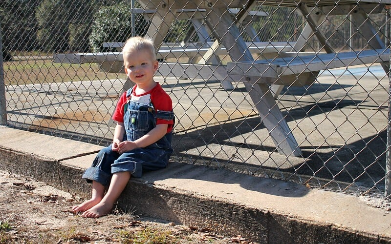 son sitting down outside