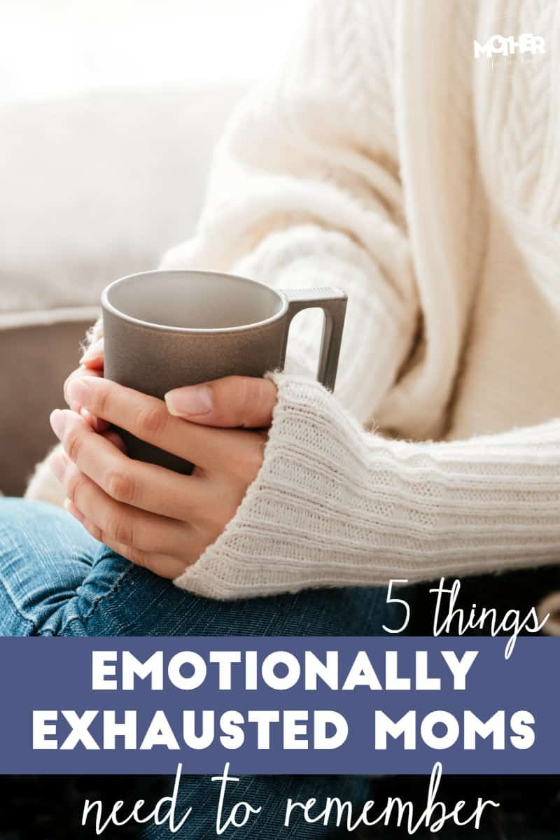 emotionally exhausted mom sitting with cup of coffee