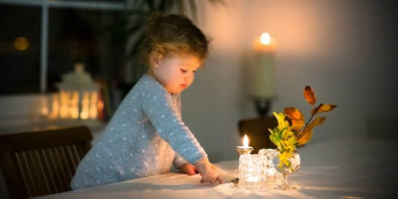 little girl at empty family table