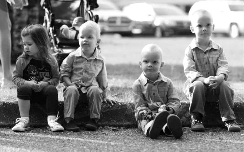 four young children sitting