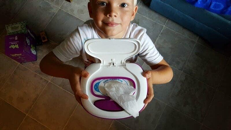 child holding up kandoo flushable wipes