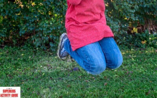 super hyper kid jumping outside
