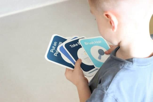 daily routine cards being held by kid