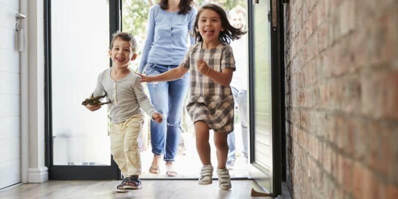 kids and mom running inside