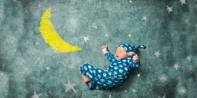 cute baby in blue pajamas sleeping