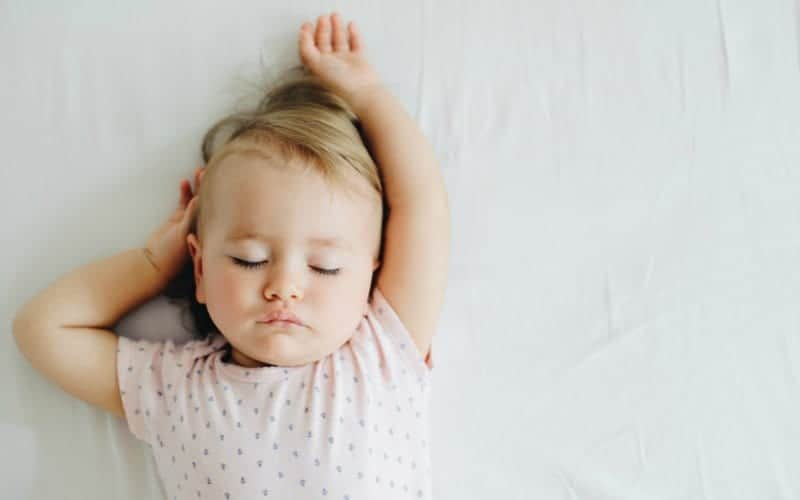 an older baby learning to sleep with sleep training