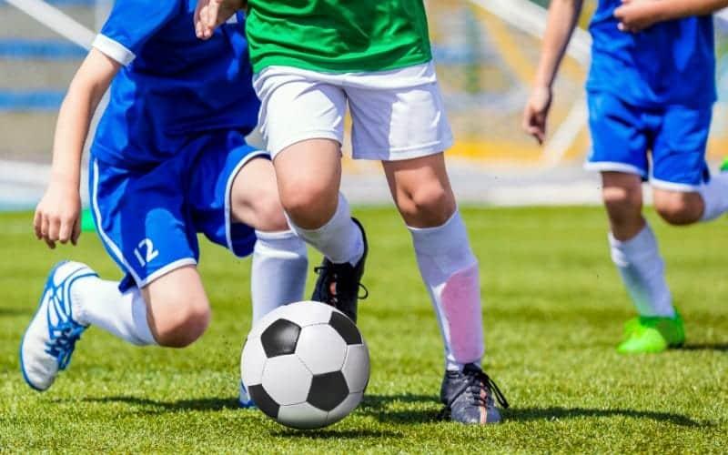 kids kicking soccer balls