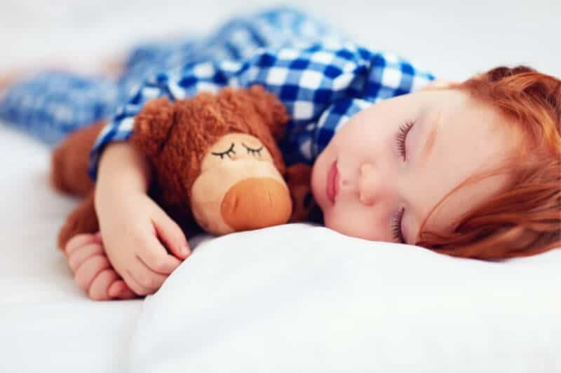 baby resting with teddy bear