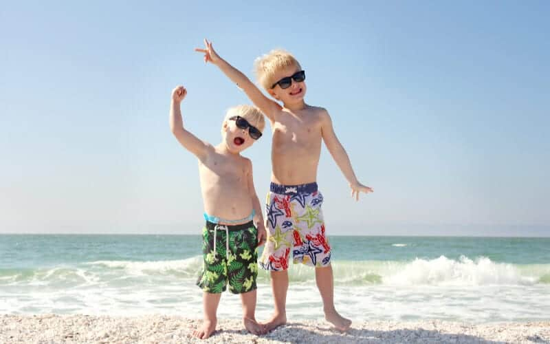 here are some tips for parenting toddlers. two kids at the beach