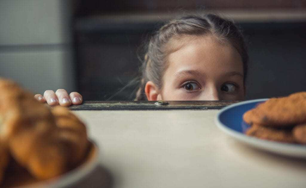 girl looking at food