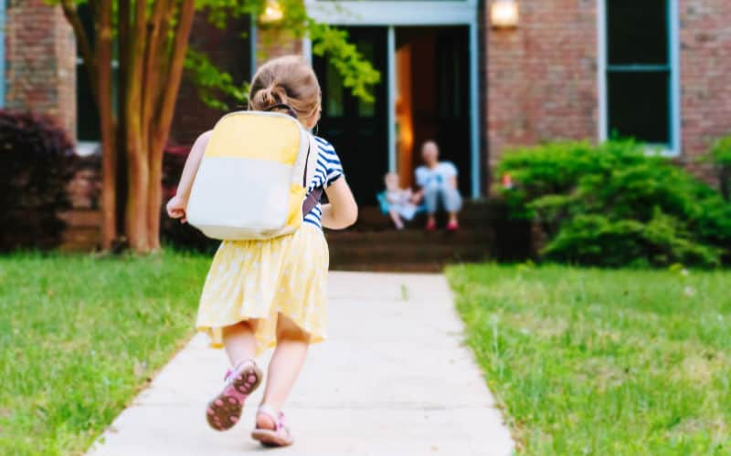 child running home from school