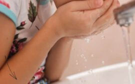 little girl washing her mouth out after she said bad words