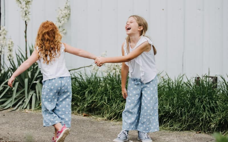 two girls laughing and playing