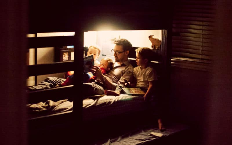 dad reading to his kids at bedtime